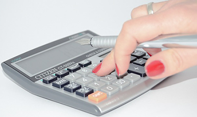 womans fingers on calculator