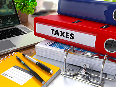 tax binders on desk