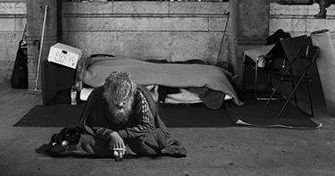 a homeless man on the street