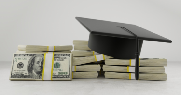 a pile of cash with a graduates cap on top